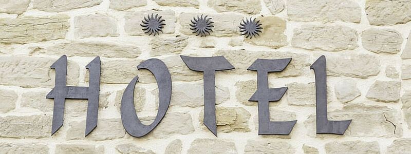 image of a hotel sign using cut out letters